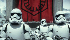 First Order Stormtroopers in front of a First Order Flag